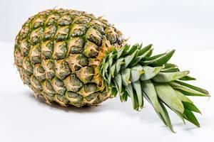 Fresh ripe whole pineapple on white background (Flip 2019)