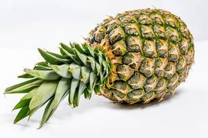 Fresh ripe whole pineapple on white background