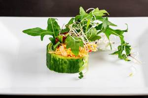 Fresh-roll with snow crab, arugula, cucumber and micro greenery