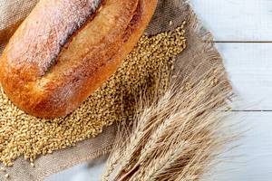 Fresh rye bread with spikelet and wheat
