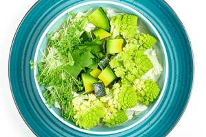 Fresh salad with avocado, romanesco cabbage and watercress. Top view (Flip 2020)