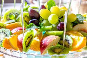 Fresh sliced fruit with mint leaves