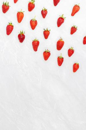 Fresh Strawberries falling from the sky as rockets with copy space
