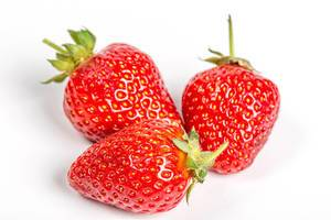 Fresh strawberries on a white background