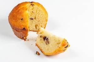 Fresh sweet sponge muffin on white background