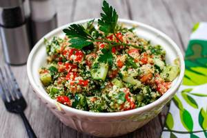 Fresh tabbouleh salad for lunch, in a ceramic bowl