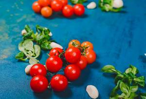 Fresh Tomatoes on Blue Background