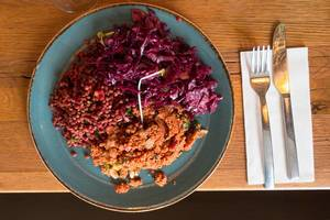 Fresh vegan salad with red cabbage, couscous and lentils