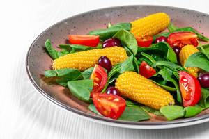 Fresh vegetable salad with spinach and dogwood close up (Flip 2019)