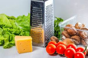 Fresh vegetables and mushrooms with cheese and grater (Flip 2019)