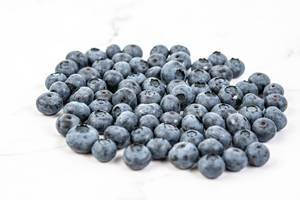 Fresh Whole Blueberries on the white background