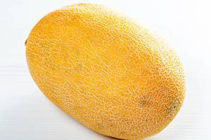 Fresh yellow melon on white wooden table (Flip 2019)