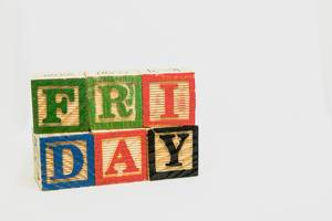 Friday text formed from wooden blocks on white background