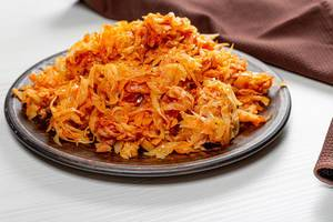 Fried cabbage in a brown plate on the table (Flip 2019)