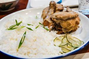 Fried chicken covered in gravy served with rice (Flip 2019)