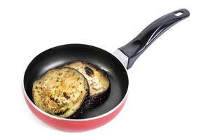 Fried Eggplant in the frying pan above white background