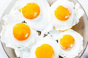 Fried eggs on a glass plate