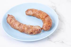 Fried Pork Sausages served on the blue plate (Flip 2019)