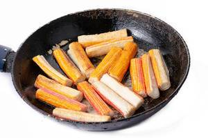 Fried Surimi Sticks in the frying pan (Flip 2019)