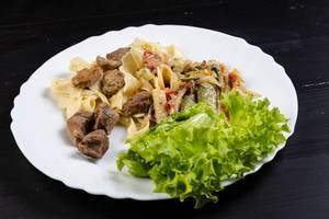 Fried Vegetables with Pork Meat and Lettuce in the plate (Flip 2019)
