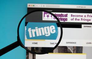 Fringe Festival logo on a computer screen with a magnifying glass