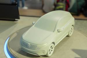 Front view of model car Mercedes EQC 400 on illuminated exhibition platform at IAA