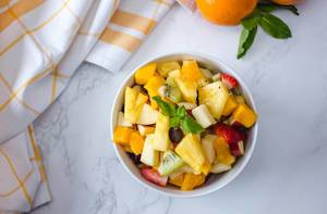 Fruit Salad With Ananas, kiwi, Apples, Strawberries, Orange and Mango Top View