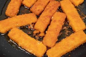 Frying Fish Sticks in the hot oil (Flip 2020)