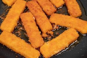 Frying-Fish-Sticks-in-the-hot-oil.jpg