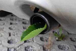 Fuel efficient car muffler with a green leaf