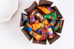 Full box of J.D. Gross Chocolate candys above white background