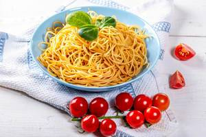 Full plate of delicious spaghetti with tomatoes