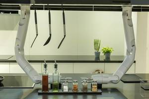 Future Kitchen with Samsung robotic arms above cooking ingredients