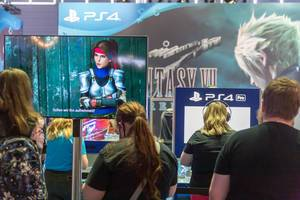 Gamers playing Final Fantasy VII Remake on PlayStation 4 at games fair Gamescom in Germany