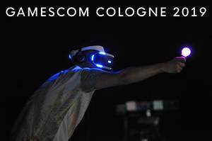 Gamescom Cologne 2019 picture shows man with vr-glasses and light cone in his hand at the the world
