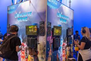 Gamescom visitors at PS4 Gaming Stations playing Concrete Genie
