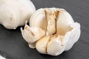 Garlic on the black stone tray