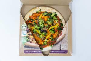 Geöffnete Packung von Holzofen-Dinkel-Pizza Verdura Vegan von followfood