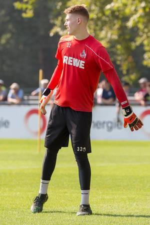 German goalkeeper Julian Krahl during football training, outside under the sun