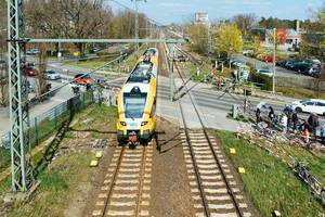 German ODEG train passing a level crossing