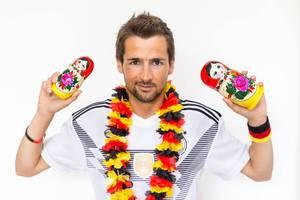German soccer fan with Russian babushka dolls