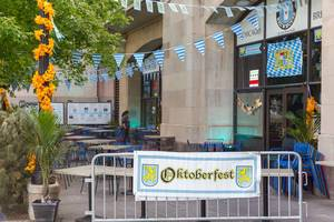 German traditions in the US: Oktoberfest celebrated with Bavarian flags, food and beer in Chicago
