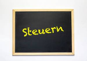 German word Steuern on blackboard