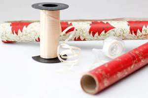 Gift wrapping paper rolls and grinding on a white background