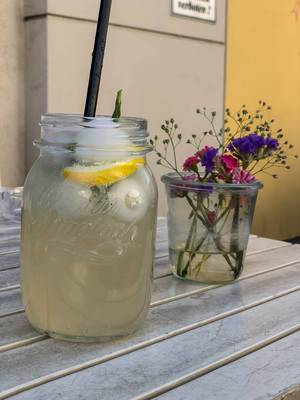 Ginger-lemon lemonade and flowers in a glass