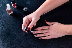 Girl paints her nails