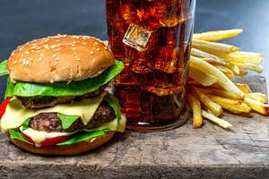Glass of Cola with ice, French fries and Burger close-up (Flip 2019)