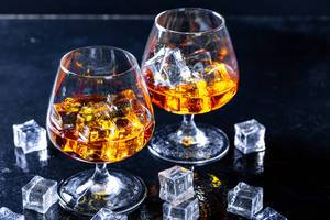 Glass with cognac closeup