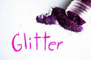 GLITTER written on a white paper