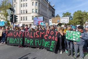 Global climate strike: Children protesting and marching to demand the end of fossil fuel projects
